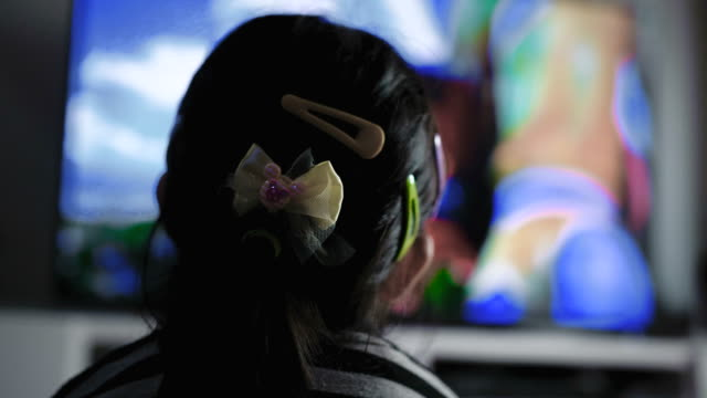 Rear View : Little Girl Watching Television