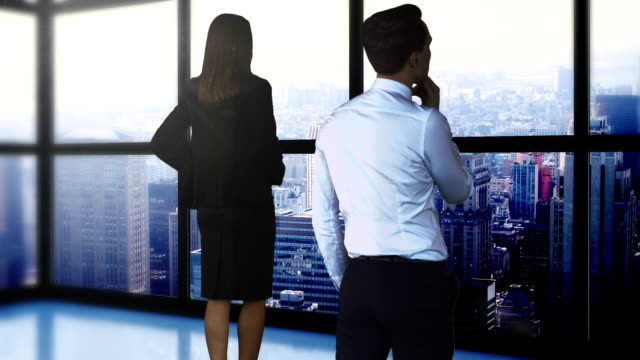 Rear view of business people are looking away Rear view of business people are looking away in the office arms akimbo stock videos & royalty-free footage