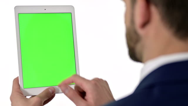 Rear View of Businessman using Tablet with Chroma Screen, White Background Rear View of Businessman using Tablet with Chroma Screen, White Background web browser stock videos & royalty-free footage