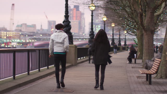 Rear View Of Couple Walking Along South Bank On Visit To London video