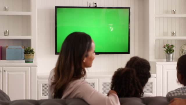 Rear View Of Family Watching Green Screen TV Shot On R3D Rear View Of Family Watching Green Screen TV Shot On R3D family watching tv stock videos & royalty-free footage