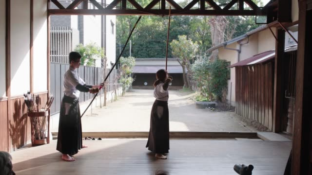 Rear View of Japanese archers practicing in their Dojo Rear View of Japanese archers practicing in their Dojo. Shot in 4K. Okayama, Japan. 2019 martial arts stock videos & royalty-free footage