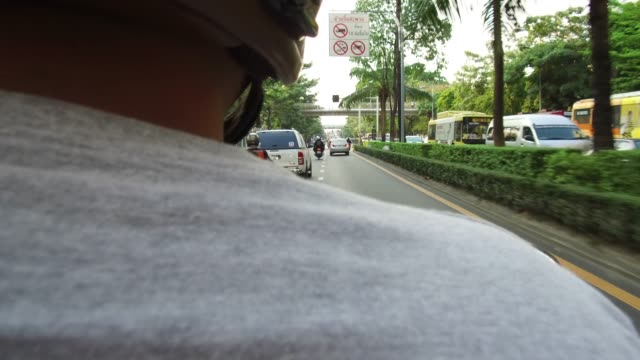 Rear view of motorcycle driver.