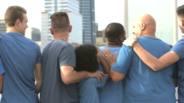 Rear view of multi-ethnic fathers and sons in city video