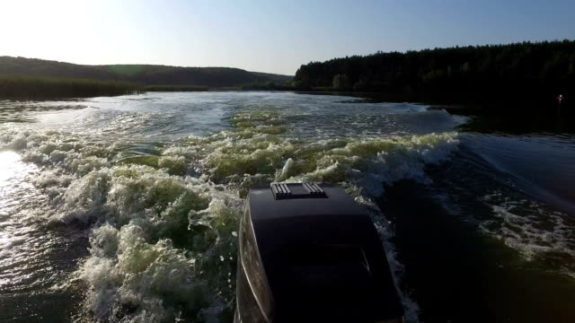 Rear view of speedboat and engine on the river video
