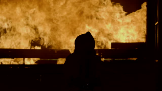 rear view : working on hell - incendio doloso video stock e b–roll
