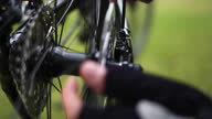 istock rear wheel of a bicycle, a man tightens a bolt with a screwdriver 1286658905