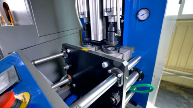 Recently produced PET bottles taken out of molding machine. video