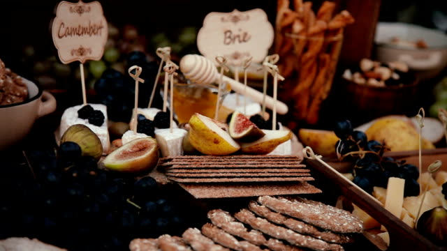 Reception at the wedding ceremony figs cheese lemonade cookies candy. video