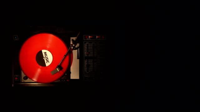 A record player turntable with it's stylus running along a vinyl record video