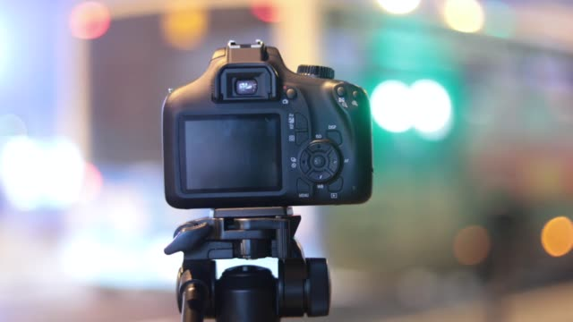 recording bokeh in city night. video production with dslr camera. - bokeh stock videos & royalty-free footage