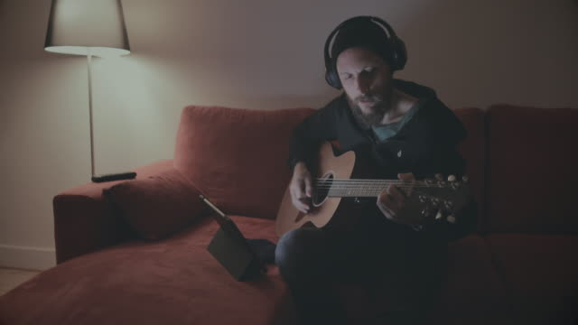 Recording studio at home: guitar and tablet