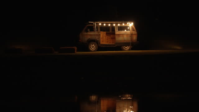 RV, Recreational vehicle, camping at the lake.Night time