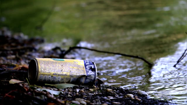 Recyclable garbage (can) near the lake. video