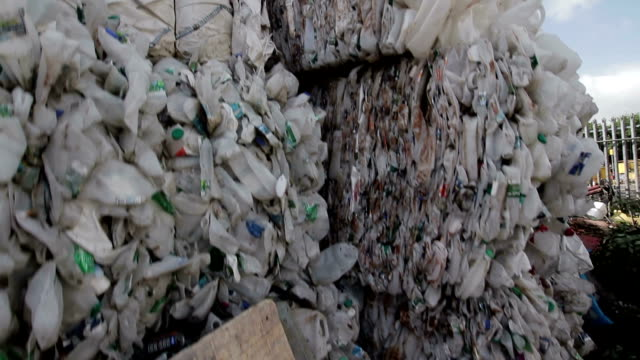 Recycled plastic bottles in stacks. video