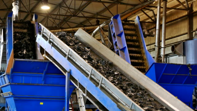 Recycling Center for Processing Rubber Conveyor belt with cut pieces of recycling tires recycling stock videos & royalty-free footage