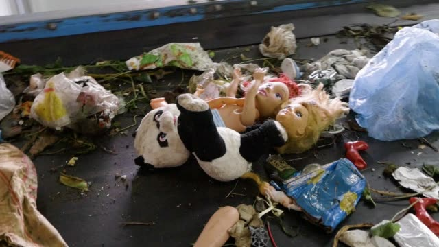 recycling plant. broken toys on conveyor belt - zabawka filmów i materiałów b-roll