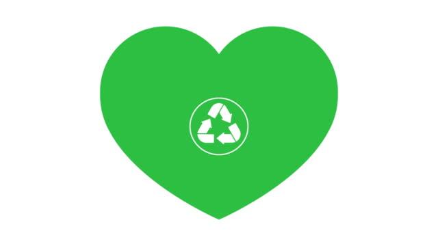 en återvinnings skylt visas i ett grönt hjärta på en vit bakgrund. - recycling heart bildbanksvideor och videomaterial från bakom kulisserna