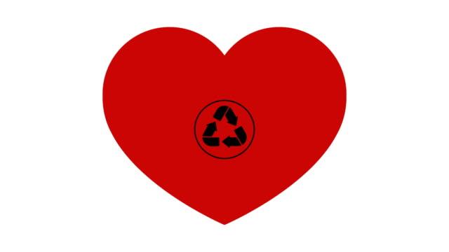 en återvinnings skylt visas inuti ett rött hjärta på en vit bakgrund. - recycling heart bildbanksvideor och videomaterial från bakom kulisserna
