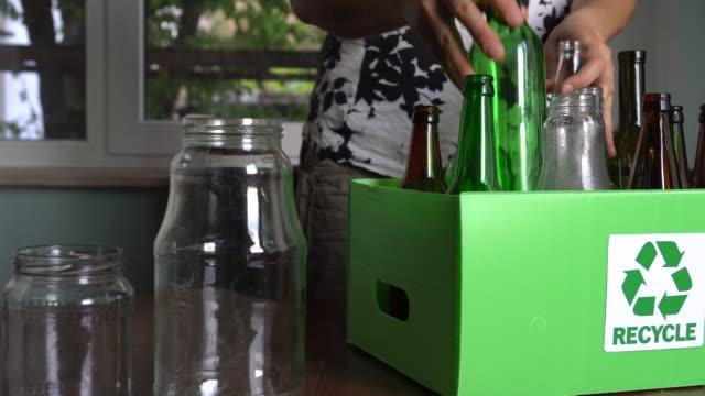 recycling used glass bottles. household glass waste collect, sort and recycle - odzyskiwanie i przetwarzanie surowców wtórnych filmów i materiałów b-roll