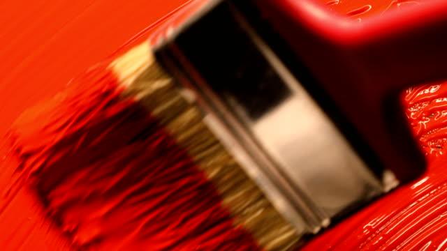 röd akryl färg med mixning med hand mixer - akrylmålning bildbanksvideor och videomaterial från bakom kulisserna