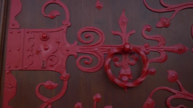 Red aged door made in gothic style