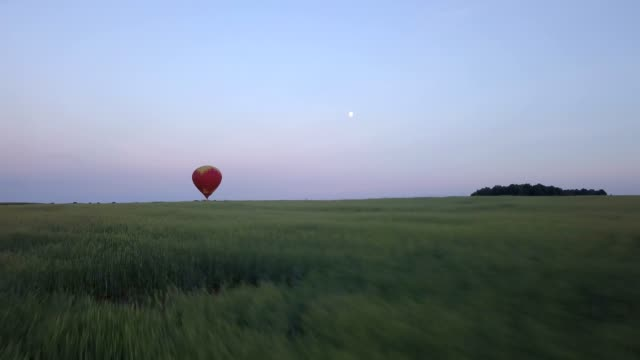 Red air balloon in the sky