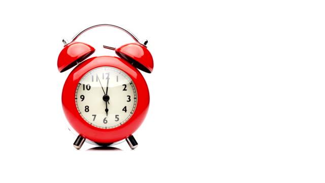 röd väckarklocka. närbild av vyn. - alarm clock bildbanksvideor och videomaterial från bakom kulisserna