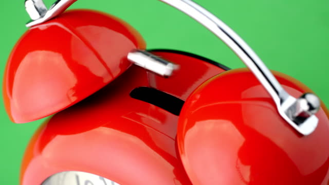 Red alarm clock. Green screen. Close up view. video