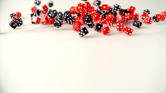 Red and black Dice rolling, Slow Motion video