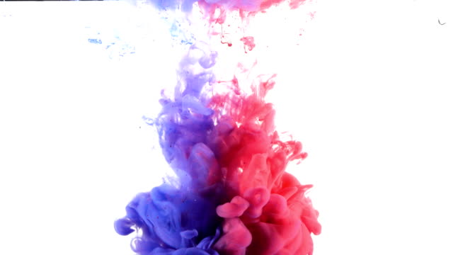 Red and blue paint squirted into water tank video
