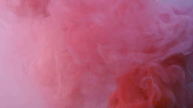 Red and Pink Smoke Thick red and pink smoke pouring out of a smoke grenade. Shot in slow motion. pink color stock videos & royalty-free footage