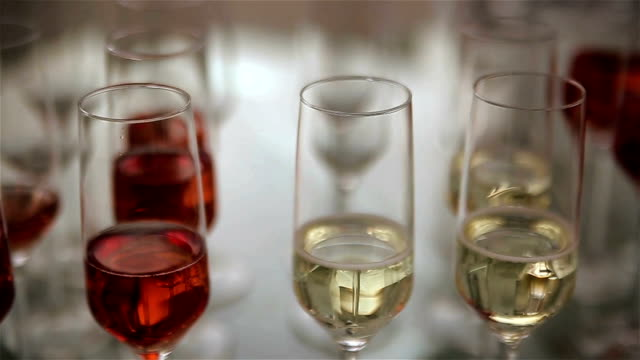 red and white wine in the glasses,preparing for party video