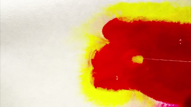 Red and yellow ink spill on white paper.Great texture background