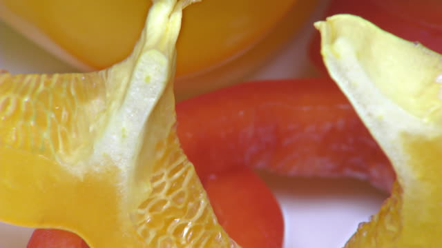 vídeos de stock e filmes b-roll de red and yellow paprika – close up, detail, macro - red bell pepper isolated