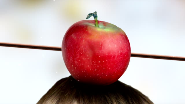 Red apple on head hit by arrow. Colorful background. video