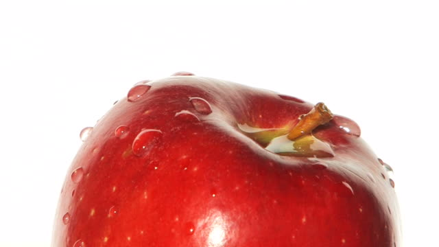 Red apple rotating - close up video
