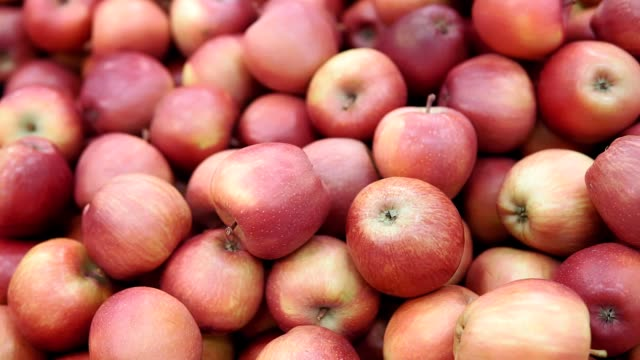 Red apples on the market counter. Apples in wooden boxes on the grocery shelf. Close up.