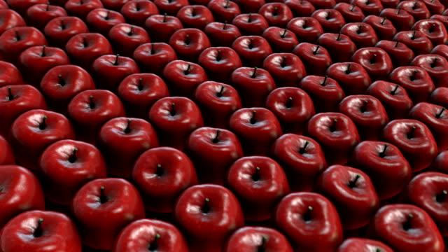 rote äpfel haufen (endlos wiederholbar) - apple stock-videos und b-roll-filmmaterial