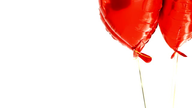 red balloons floating in the air 4k - simbolo concettuale video stock e b–roll