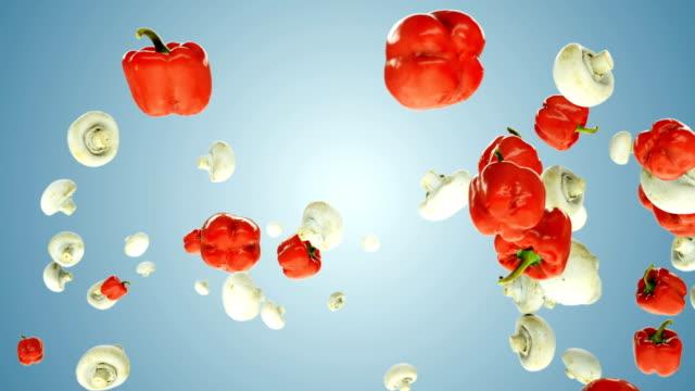 red bell pepper and mushrooms flying in slow motion, against blue gradient - węglowodan jedzenie filmów i materiałów b-roll