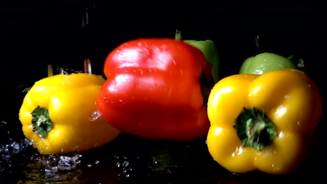 Red Bell Pepper Falling Against Black Background video