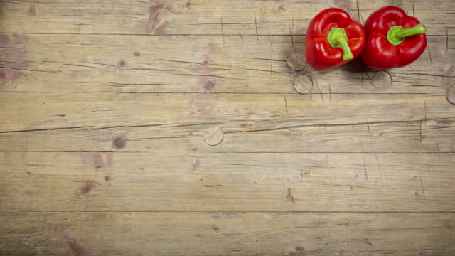 red bell pepper on wooden background, stop motion - paprica video stock e b–roll