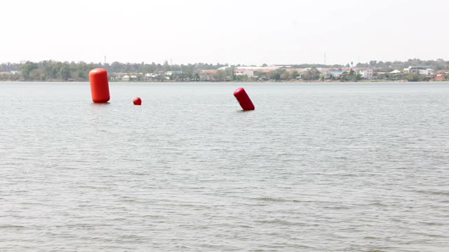 Red buoy on water video