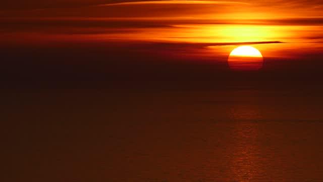 Red burning sunrise sky video