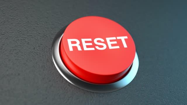 vidéos et rushes de bouton rouge symbolisant la réinitialisation - rafraîchissement