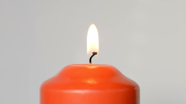 Red candle flame video