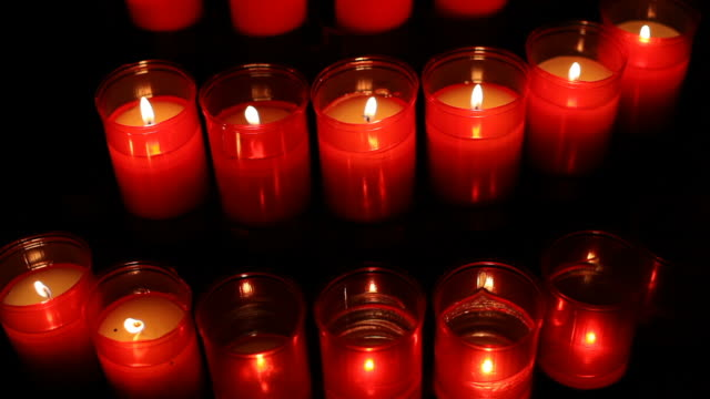 Red candles in the church video