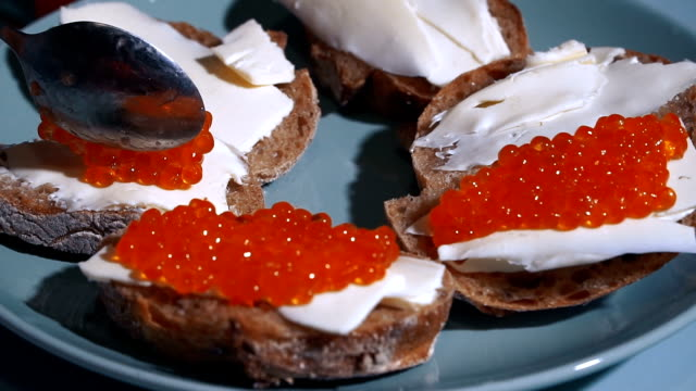Red caviar. Sandwiches with red caviar video