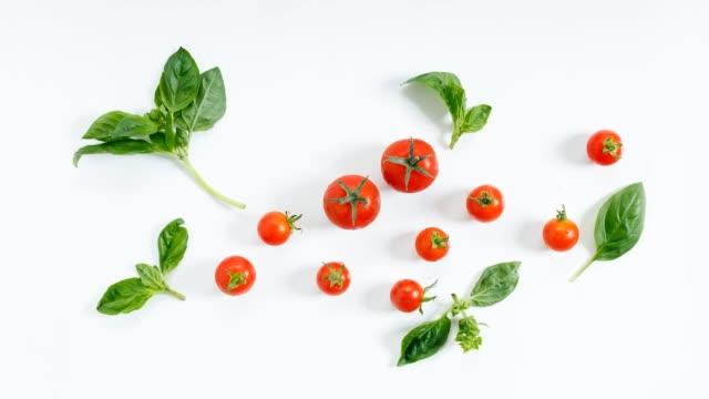 red cherry tomato on white background